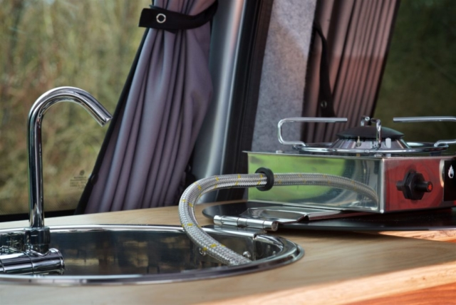 VW caddy campervan conversion close up of a CAN foldy sink and hob